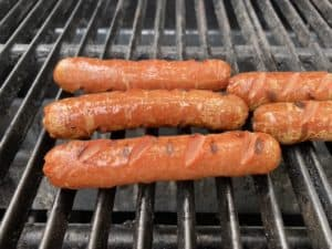 Grilled Hot Dogs with slices across top