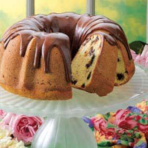 chocolate chip pound cake with chocolate glaze sitting on a plate